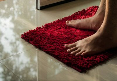 bathroom-mat-men-foot-on-red-doormat